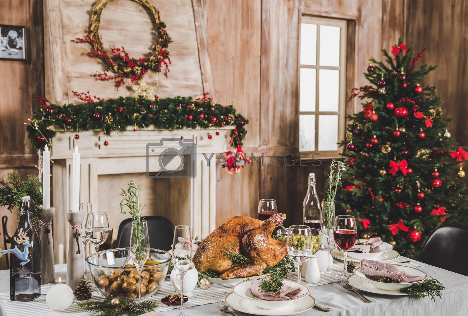 Delicious roasted turkey on served holiday table decorated for Christmas