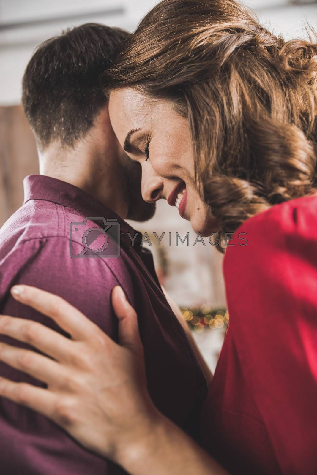 Close-up portrait of beautiful smiling couple hugging