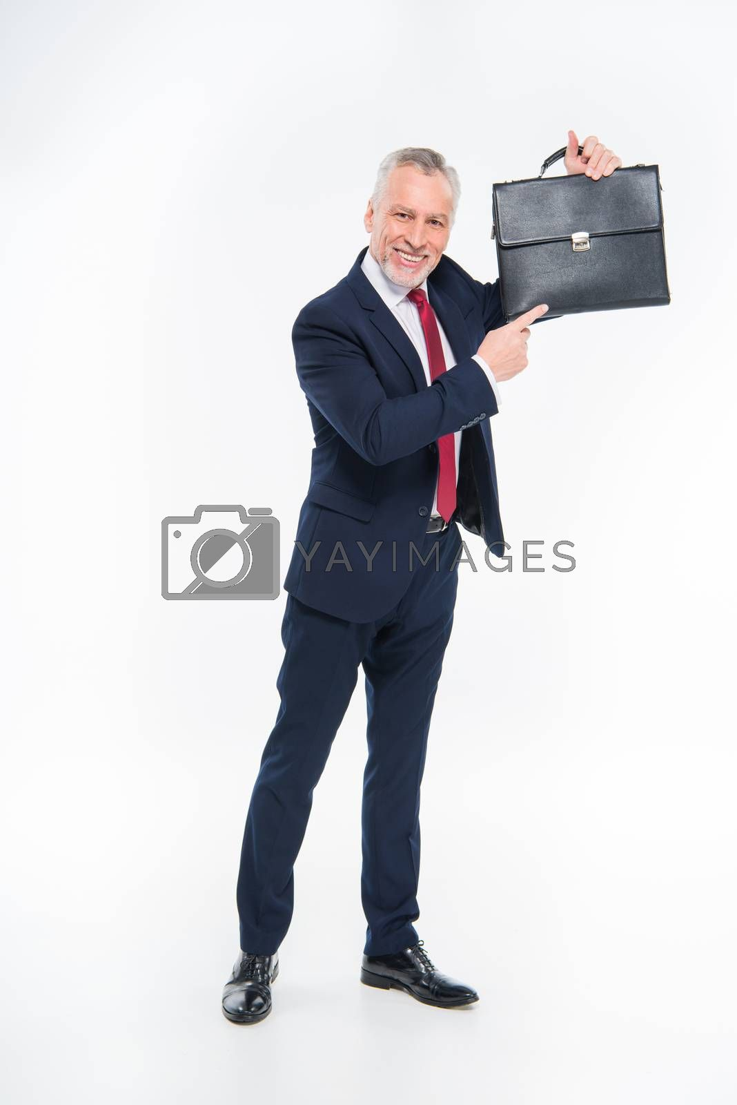 Royalty free image of Businessman pointing at briefcase by LightFieldStudios