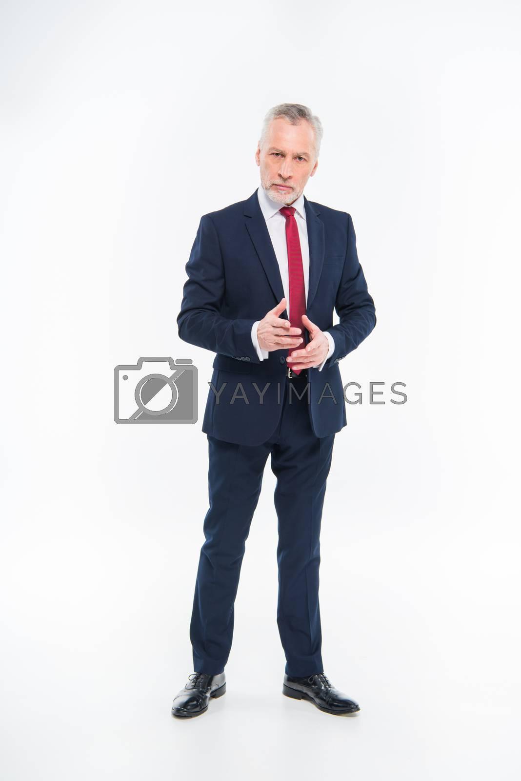 Mature businessman gesturing   by LightFieldStudios