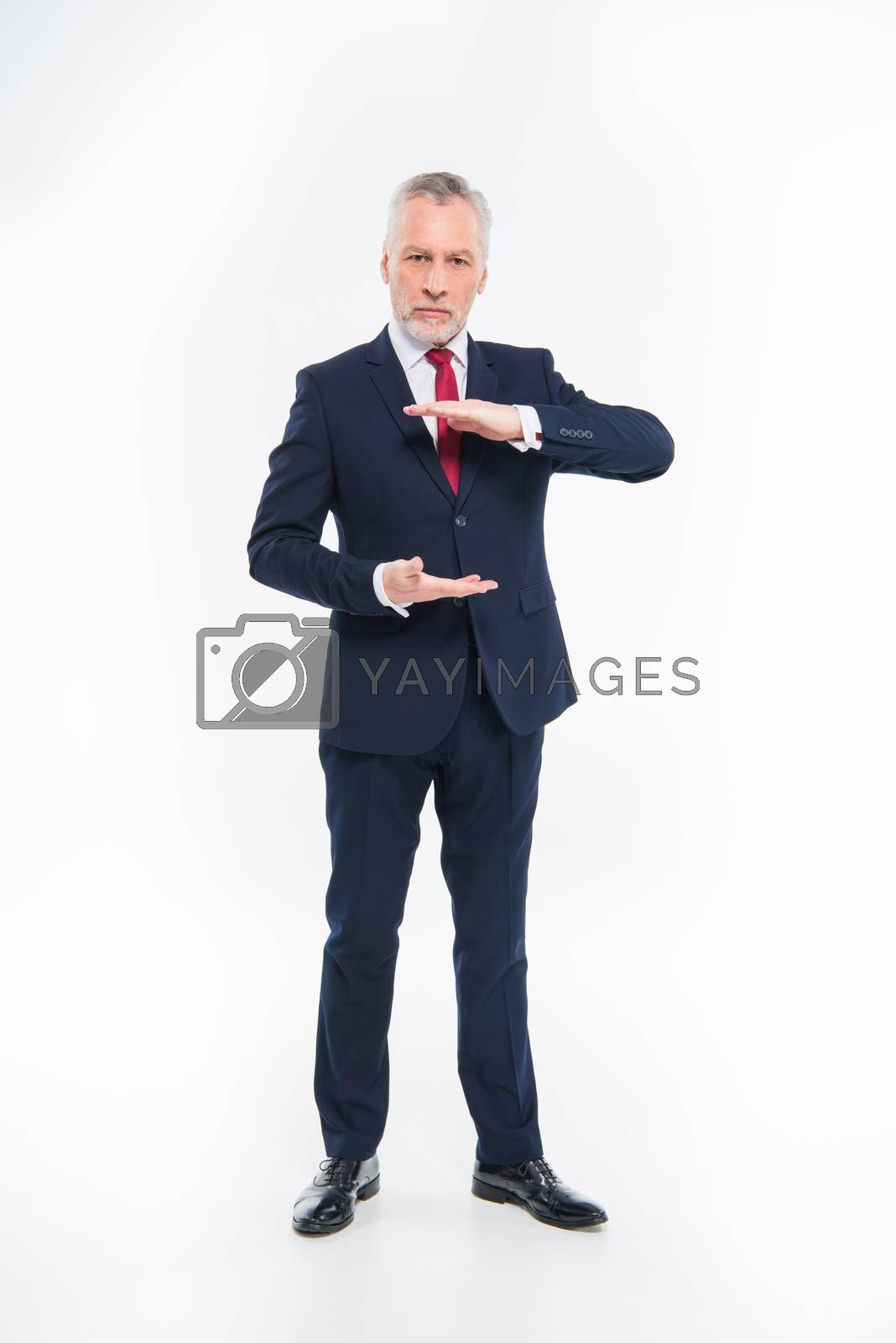 Royalty free image of Mature businessman gesturing   by LightFieldStudios
