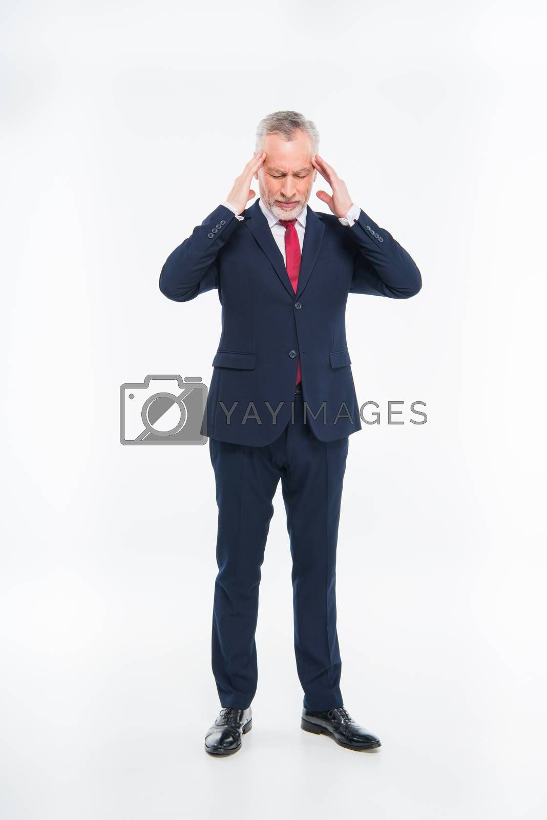 Stressed mature businessman with hands on head