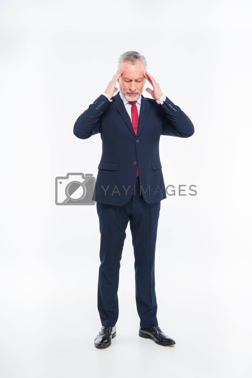 Royalty free image of Stressed mature businessman by LightFieldStudios