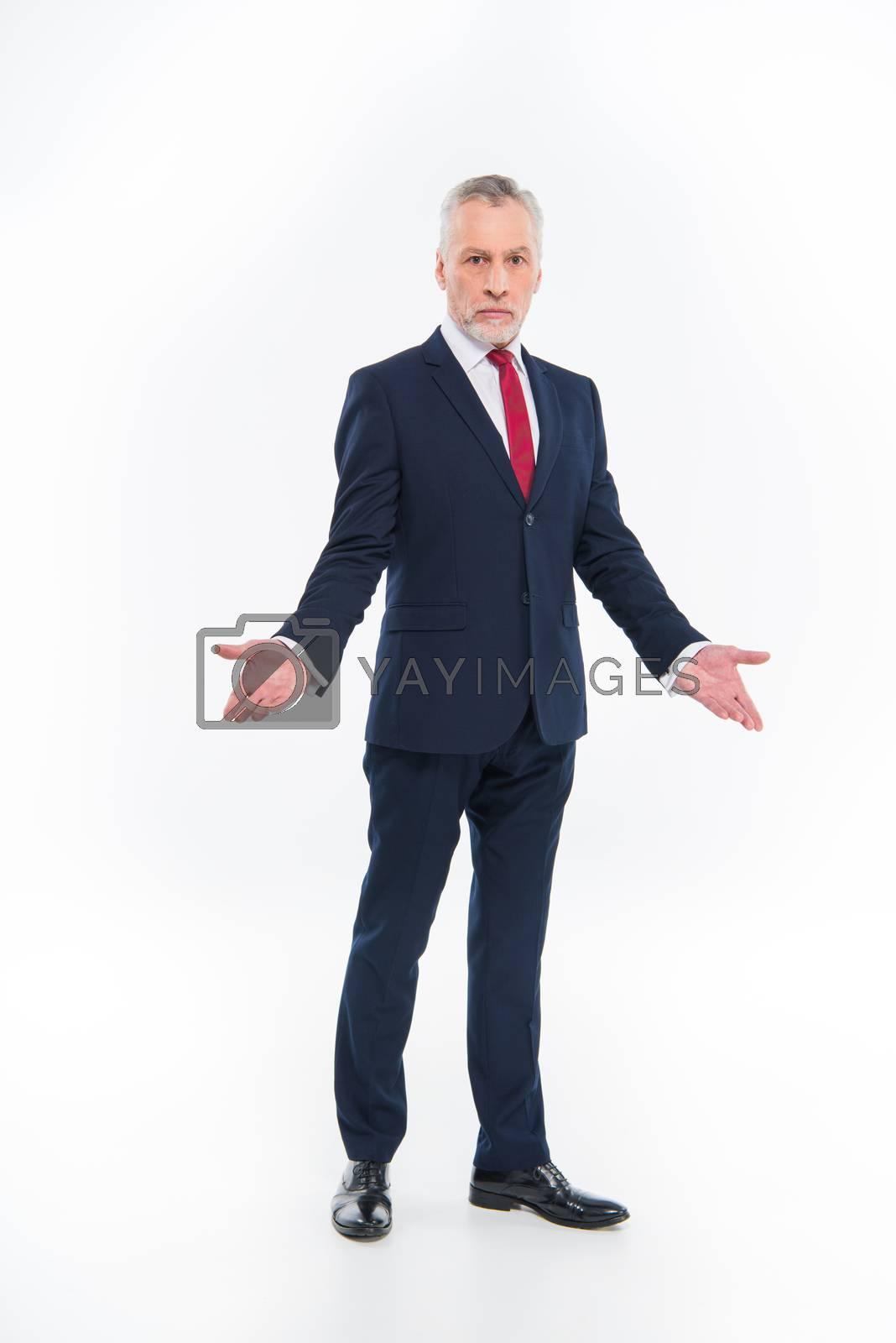 Confused mature businessman by LightFieldStudios