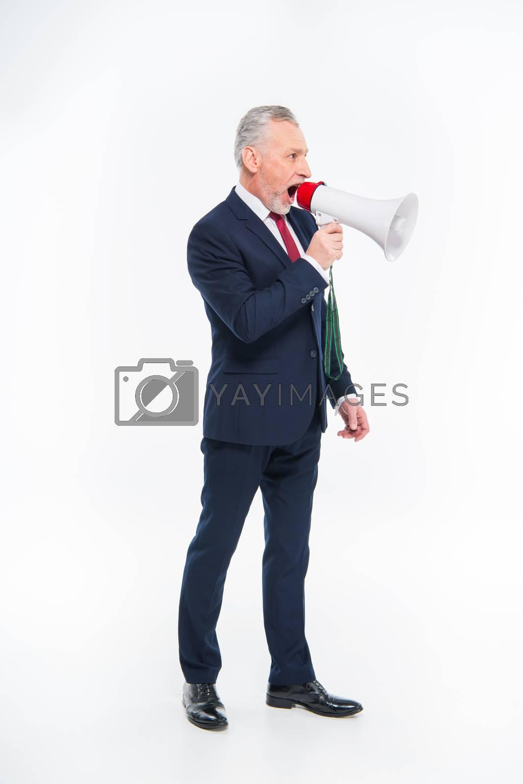 Royalty free image of Businessman shouting in loudspeaker  by LightFieldStudios