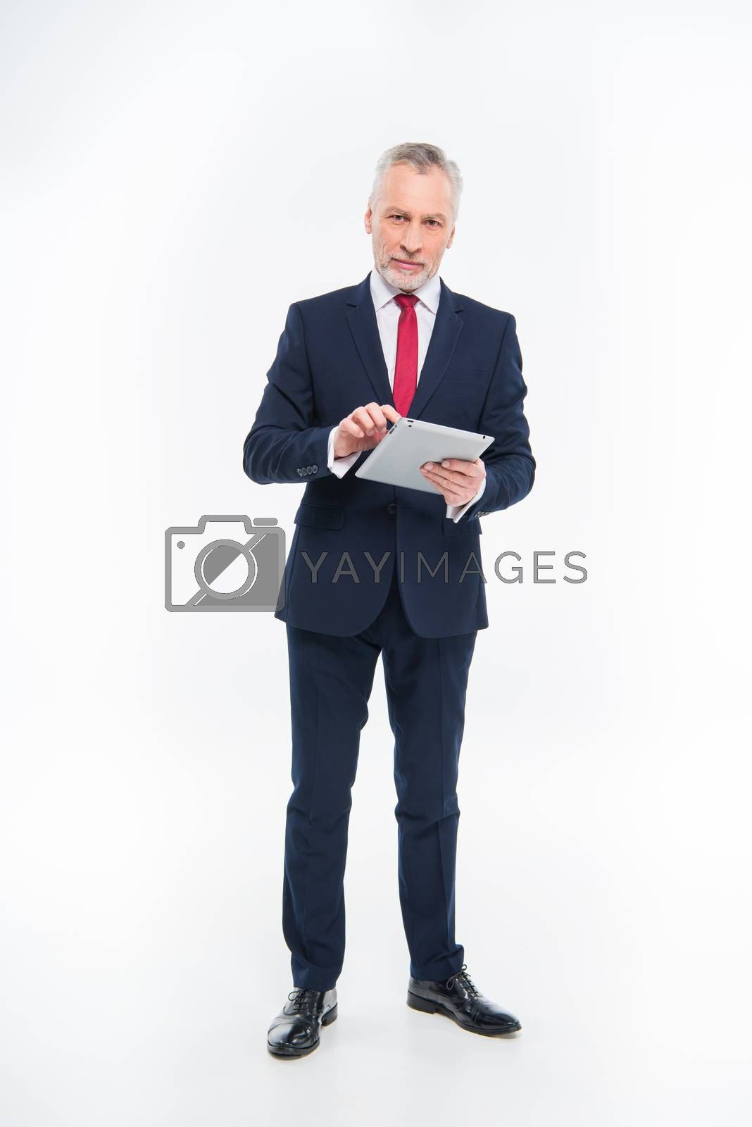 Royalty free image of Businessman using digital tablet  by LightFieldStudios