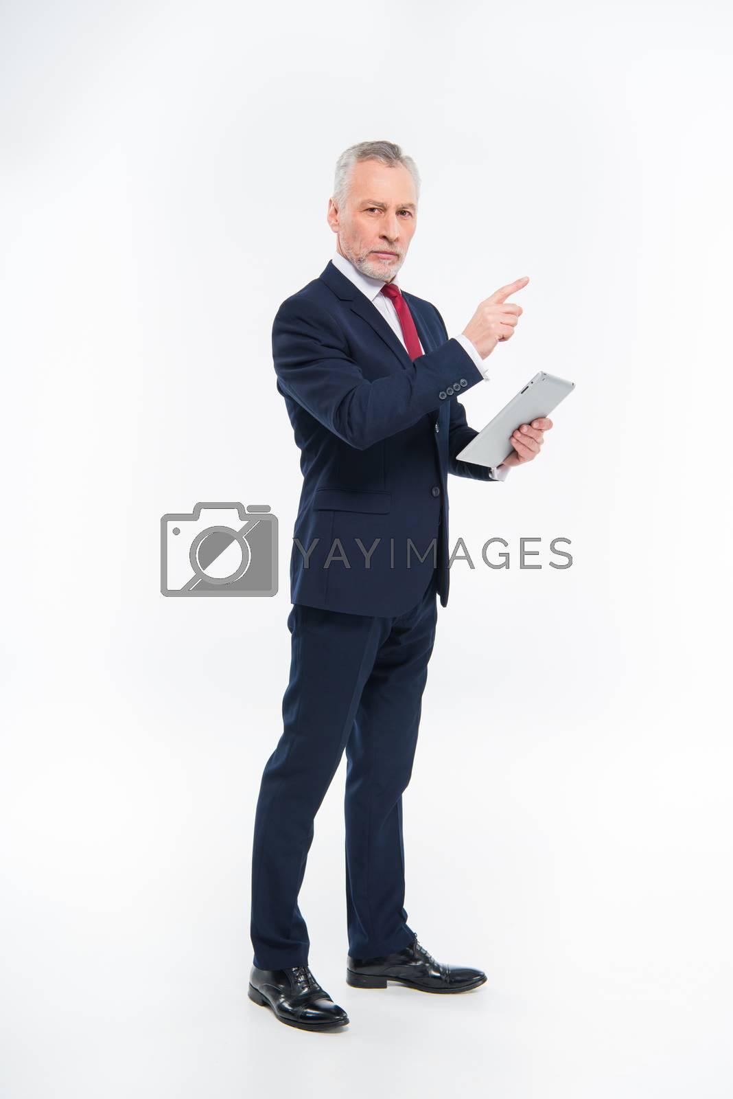 Royalty free image of Businessman holding digital tablet by LightFieldStudios