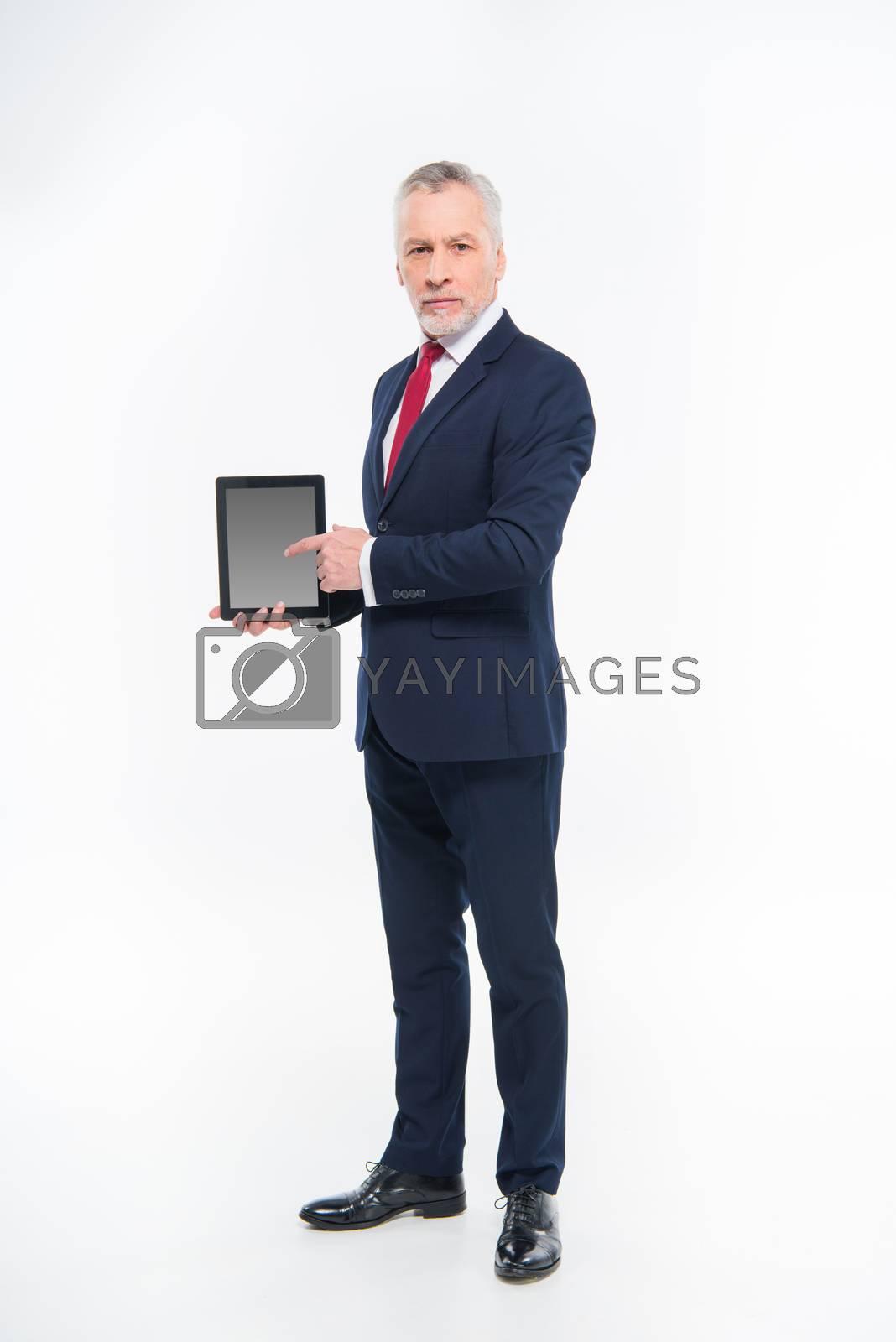 Businessman holding digital tablet by LightFieldStudios
