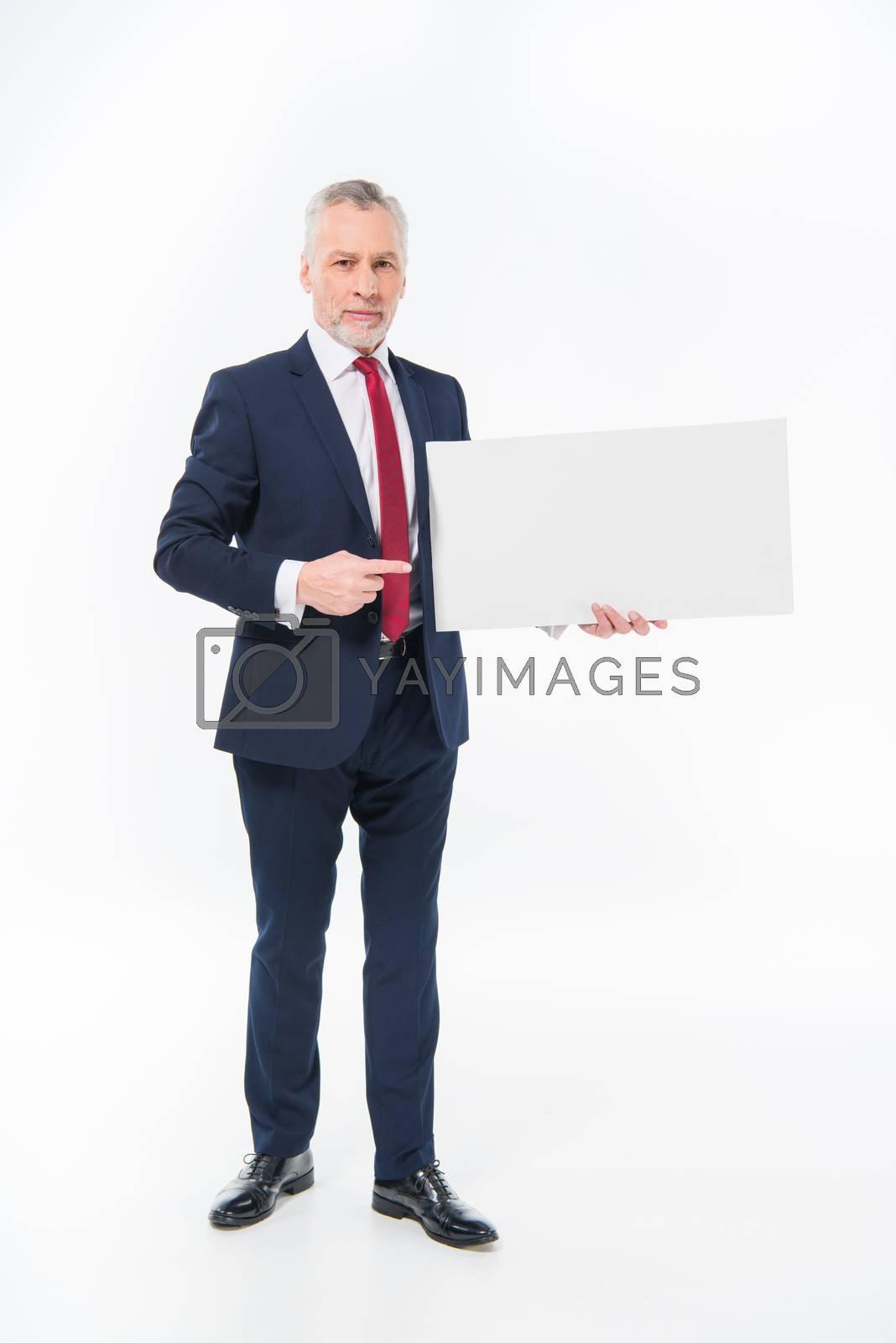 Royalty free image of Businessman holding blank card by LightFieldStudios