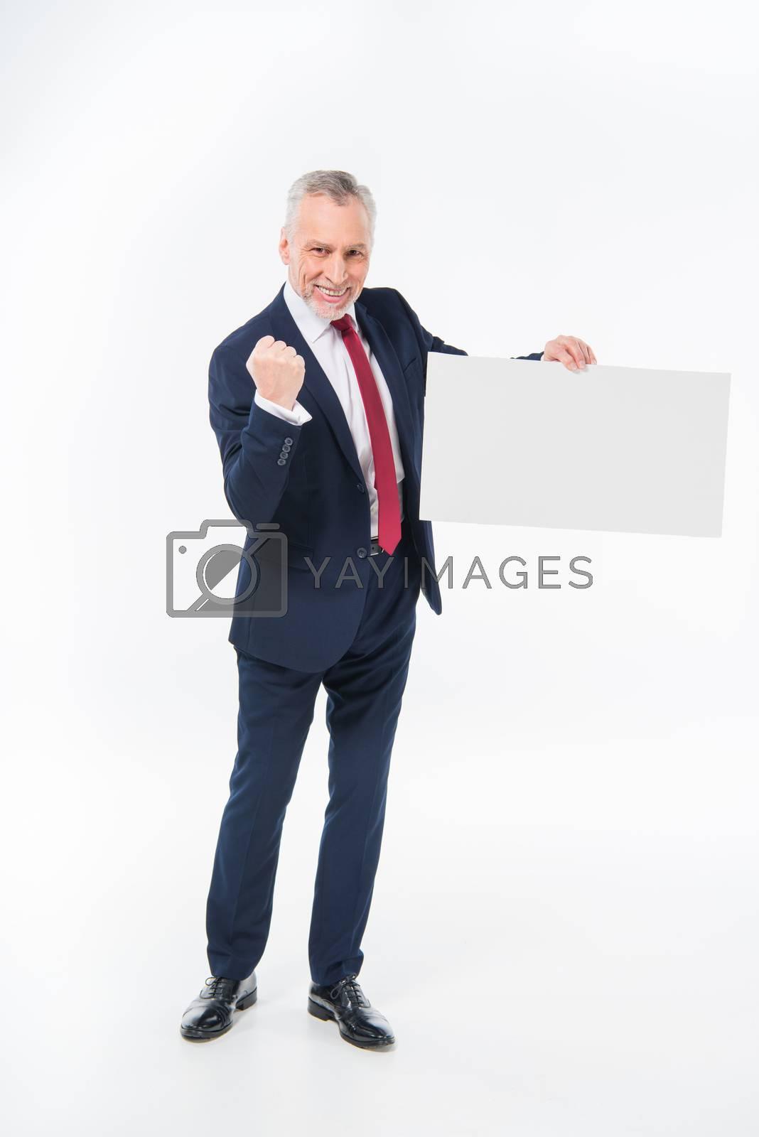 Businessman holding blank card by LightFieldStudios