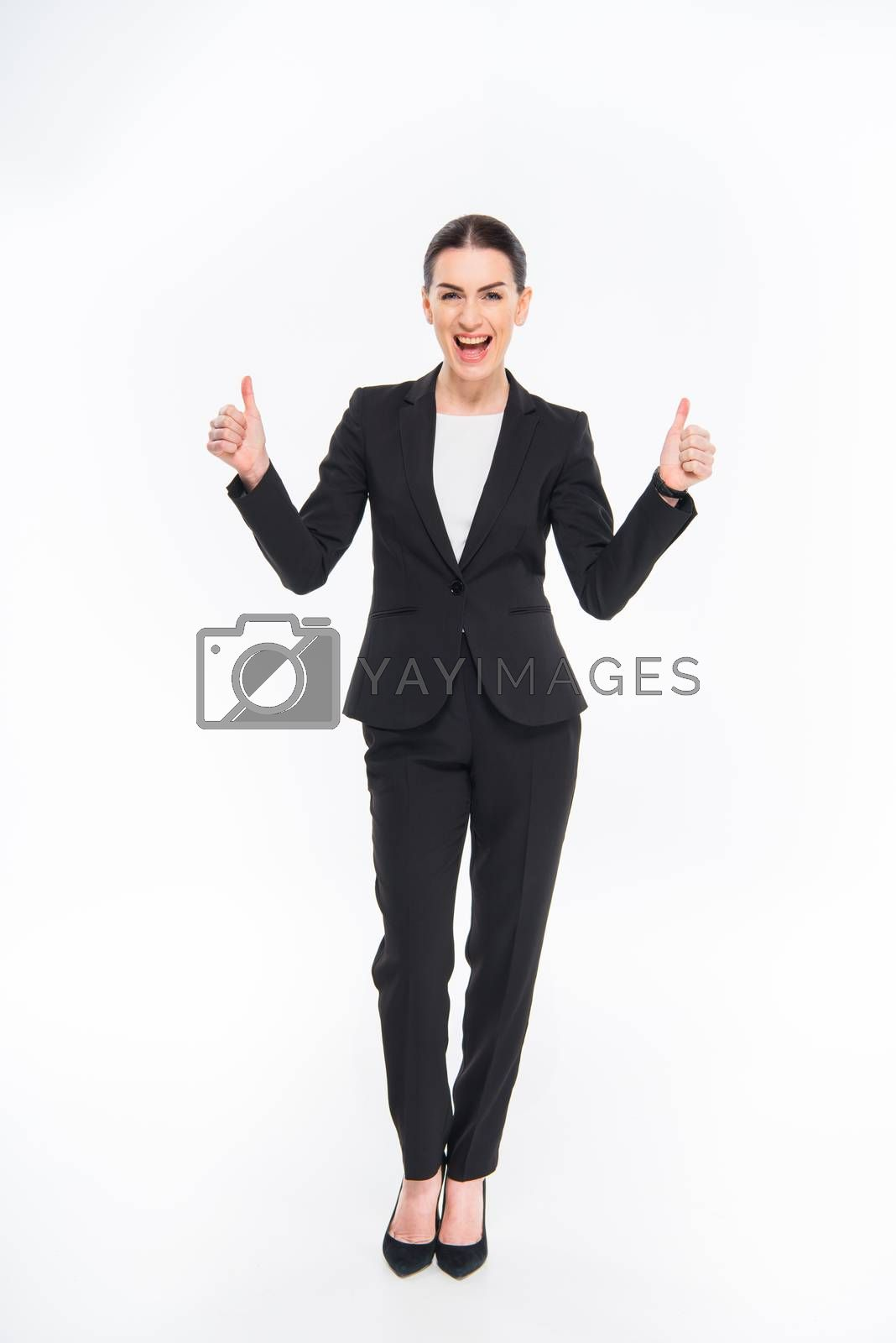 Royalty free image of Businesswoman showing thumbs up by LightFieldStudios