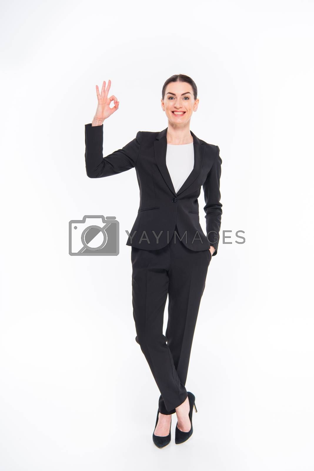Royalty free image of Businesswoman showing OK sign  by LightFieldStudios