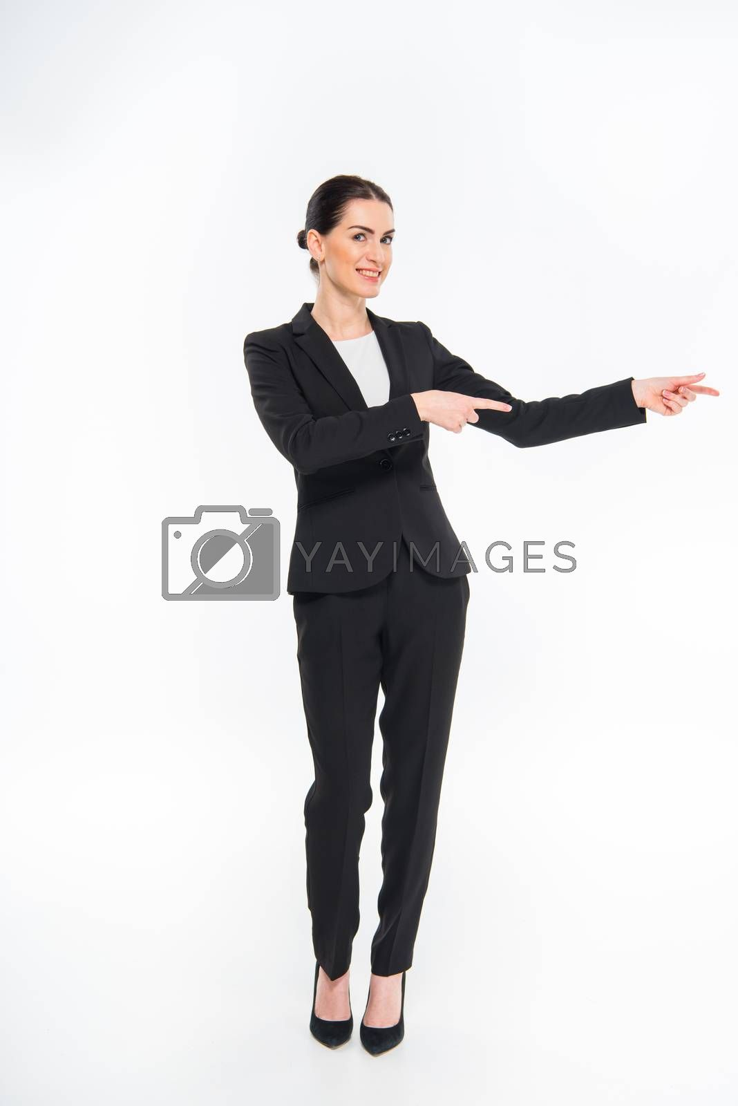 Businesswoman pointing with fingers    by LightFieldStudios