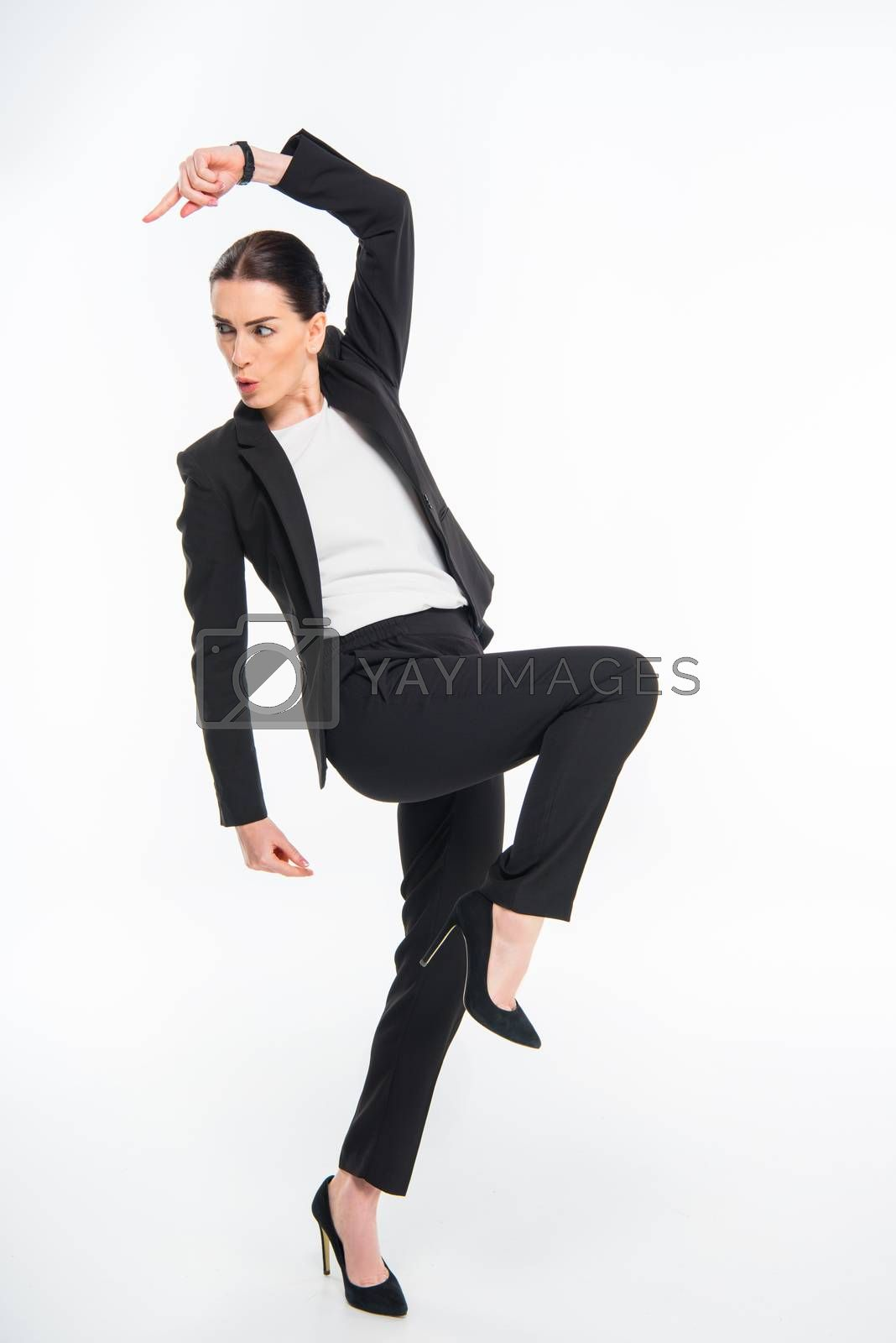 Cheerful attractive businesswoman triumphing and dancing on white
