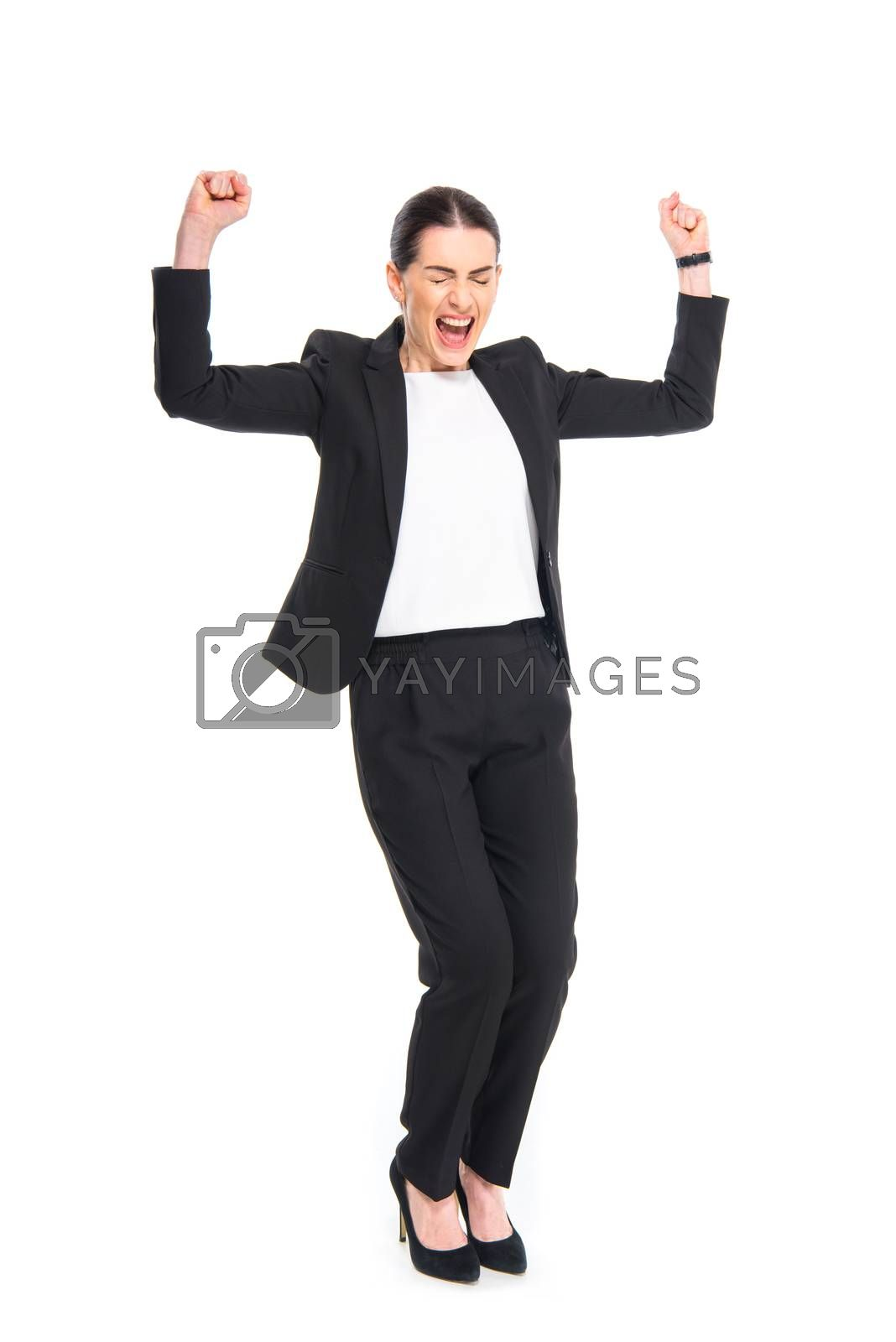 Cheerful businesswoman triumphing by LightFieldStudios