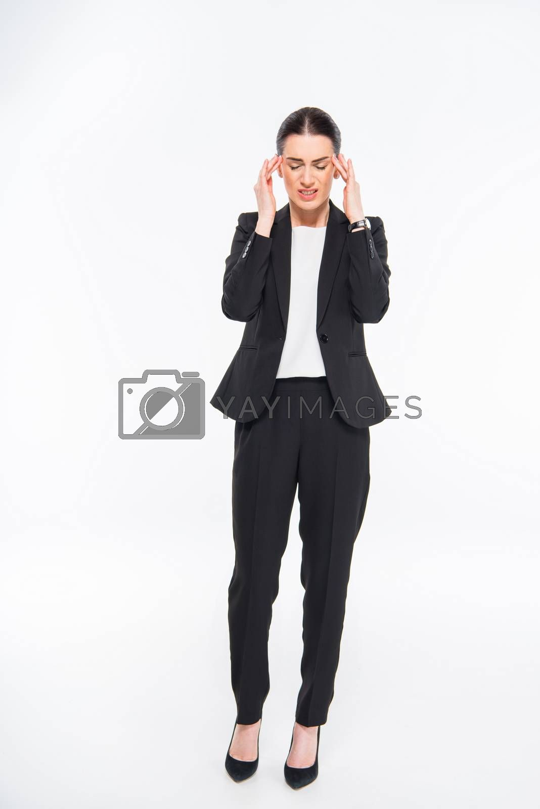 Tired businesswoman with headache by LightFieldStudios