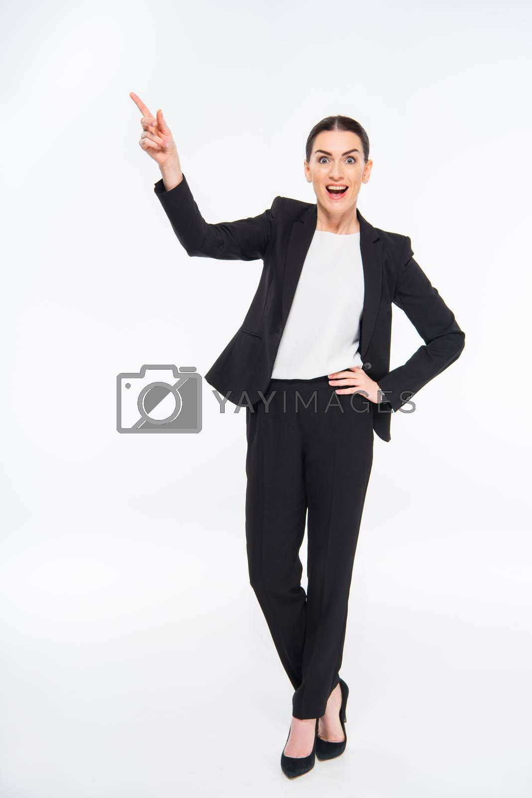 Royalty free image of Surprised businesswoman pointing by LightFieldStudios