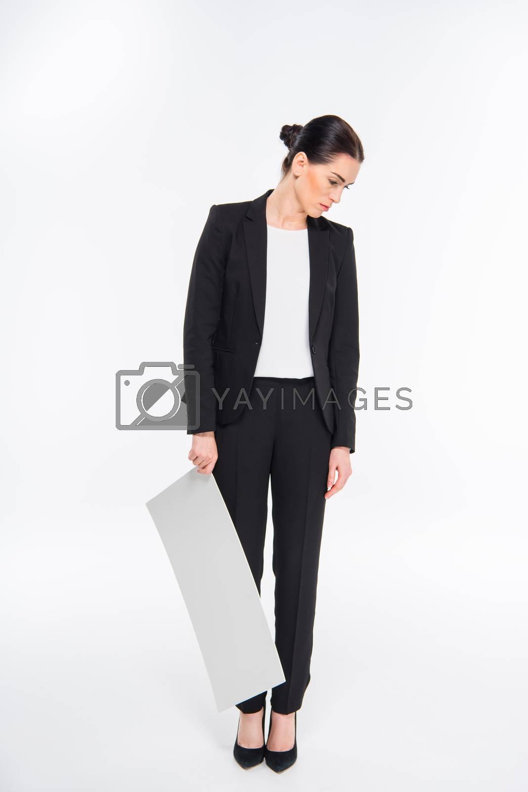 Businesswoman holding blank card by LightFieldStudios