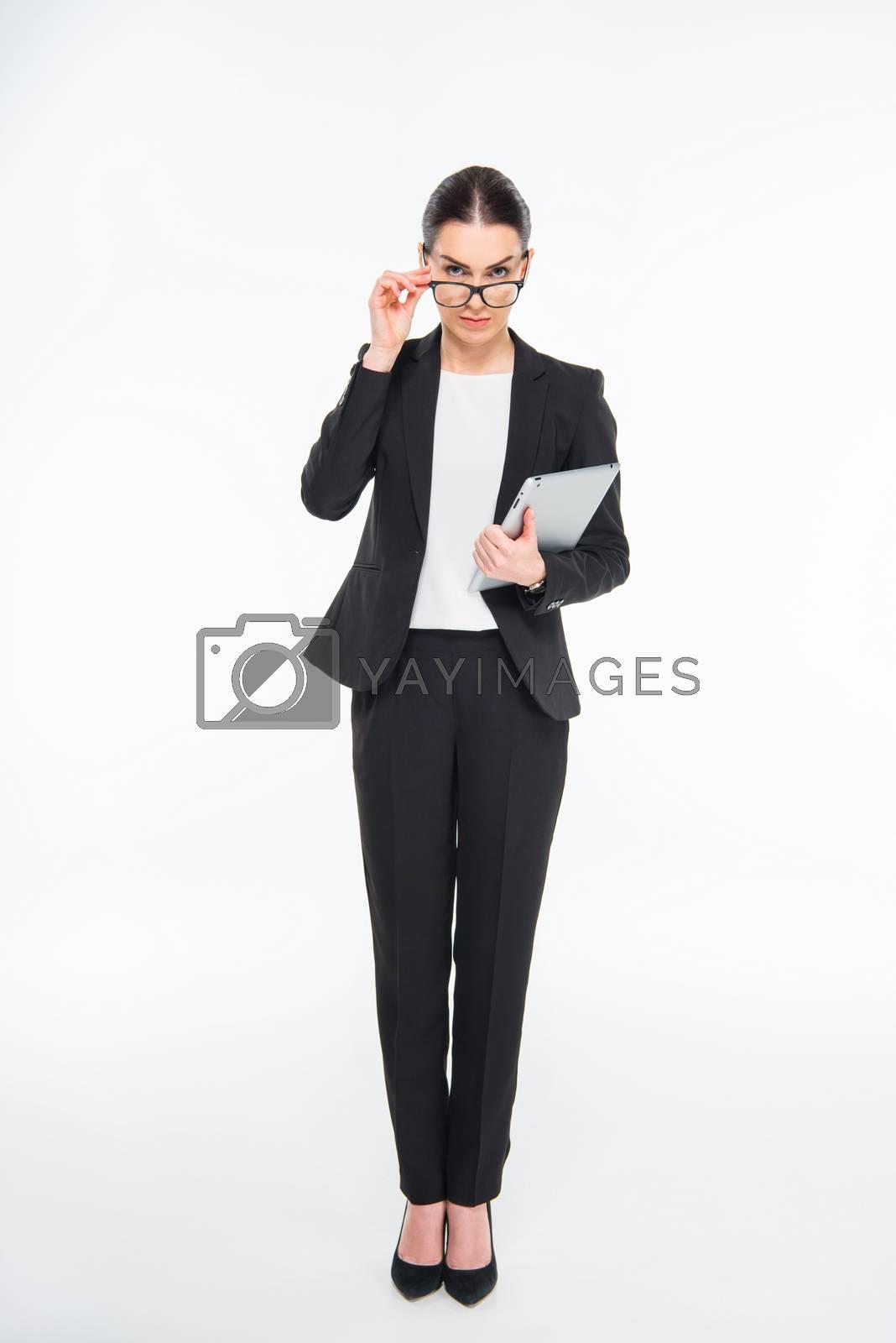 Royalty free image of Businesswoman holding digital tablet by LightFieldStudios