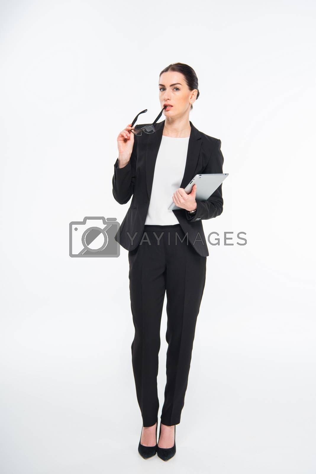 Businesswoman holding digital tablet by LightFieldStudios