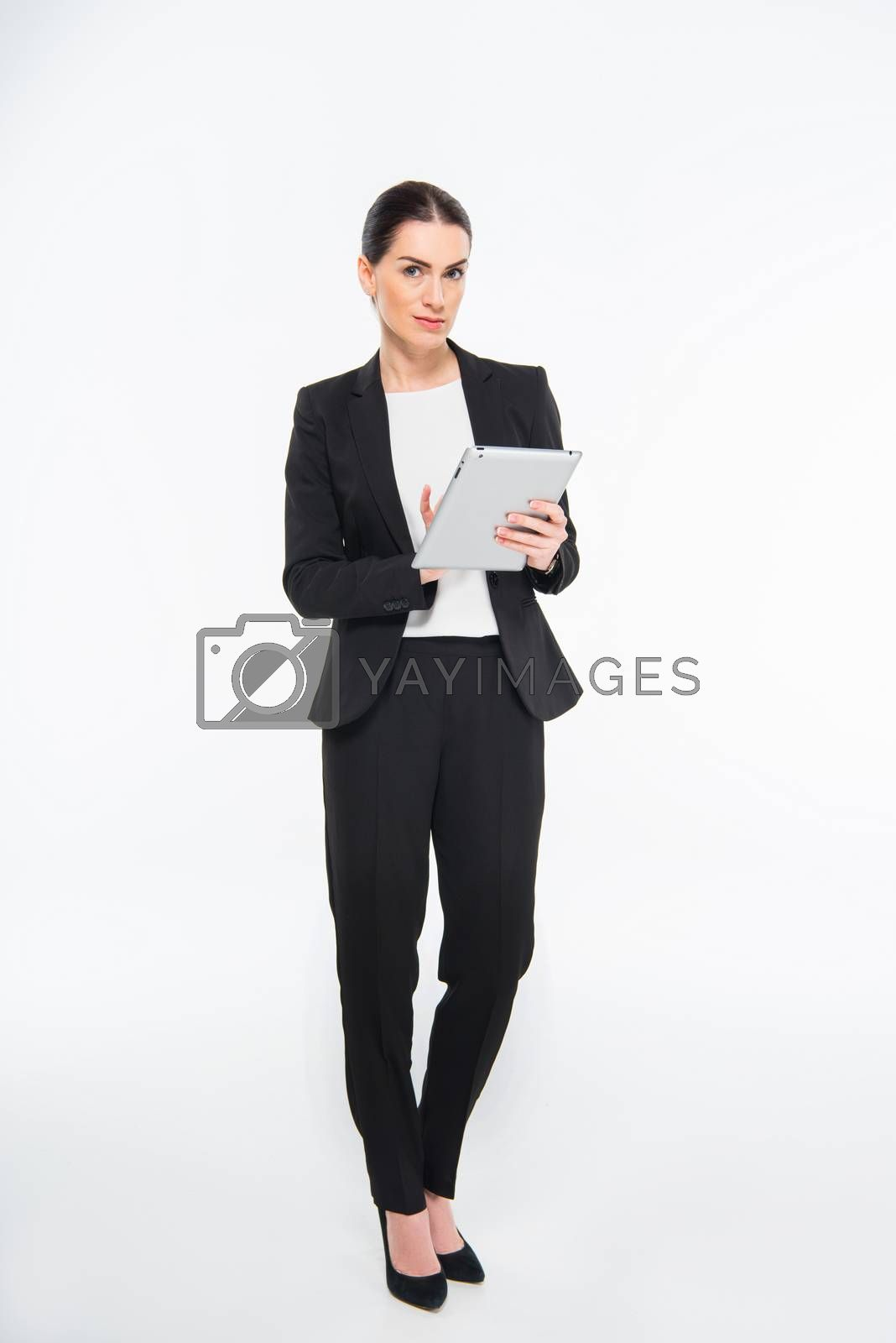 Businesswoman using digital tablet by LightFieldStudios