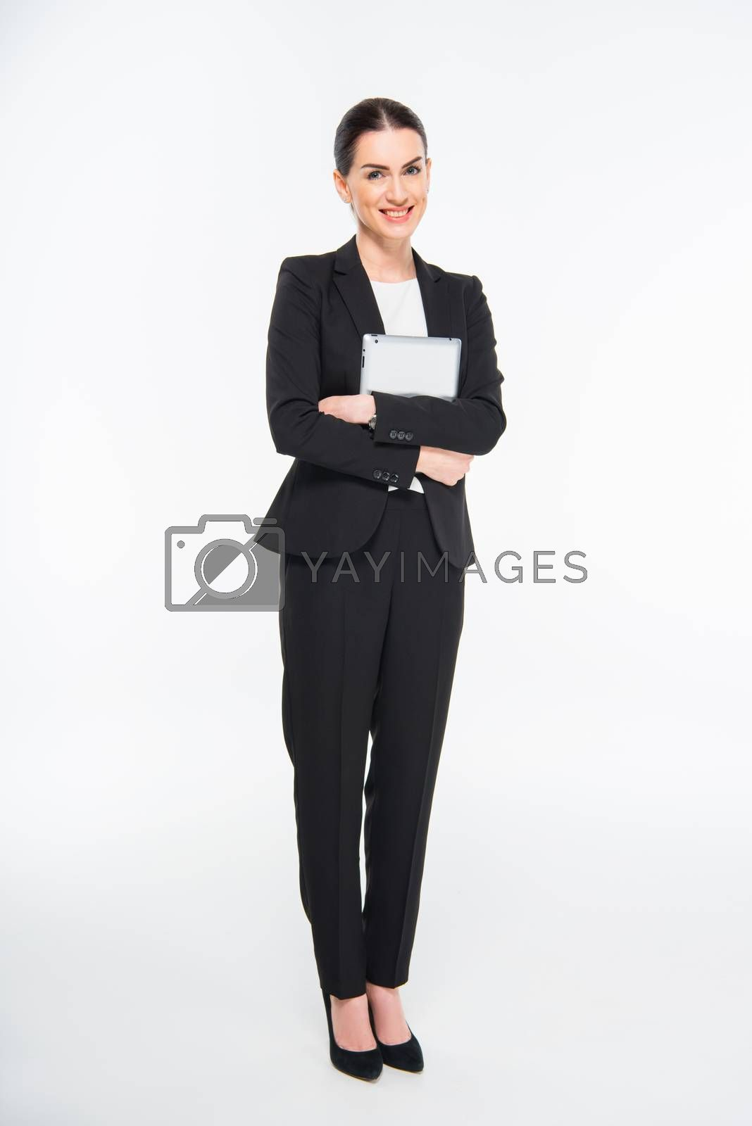 Businesswoman holding digital tablet and smiling at camera