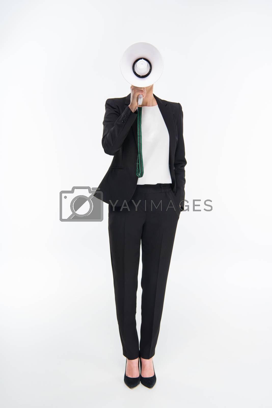 Professional young businesswoman holding megaphone and speaking
