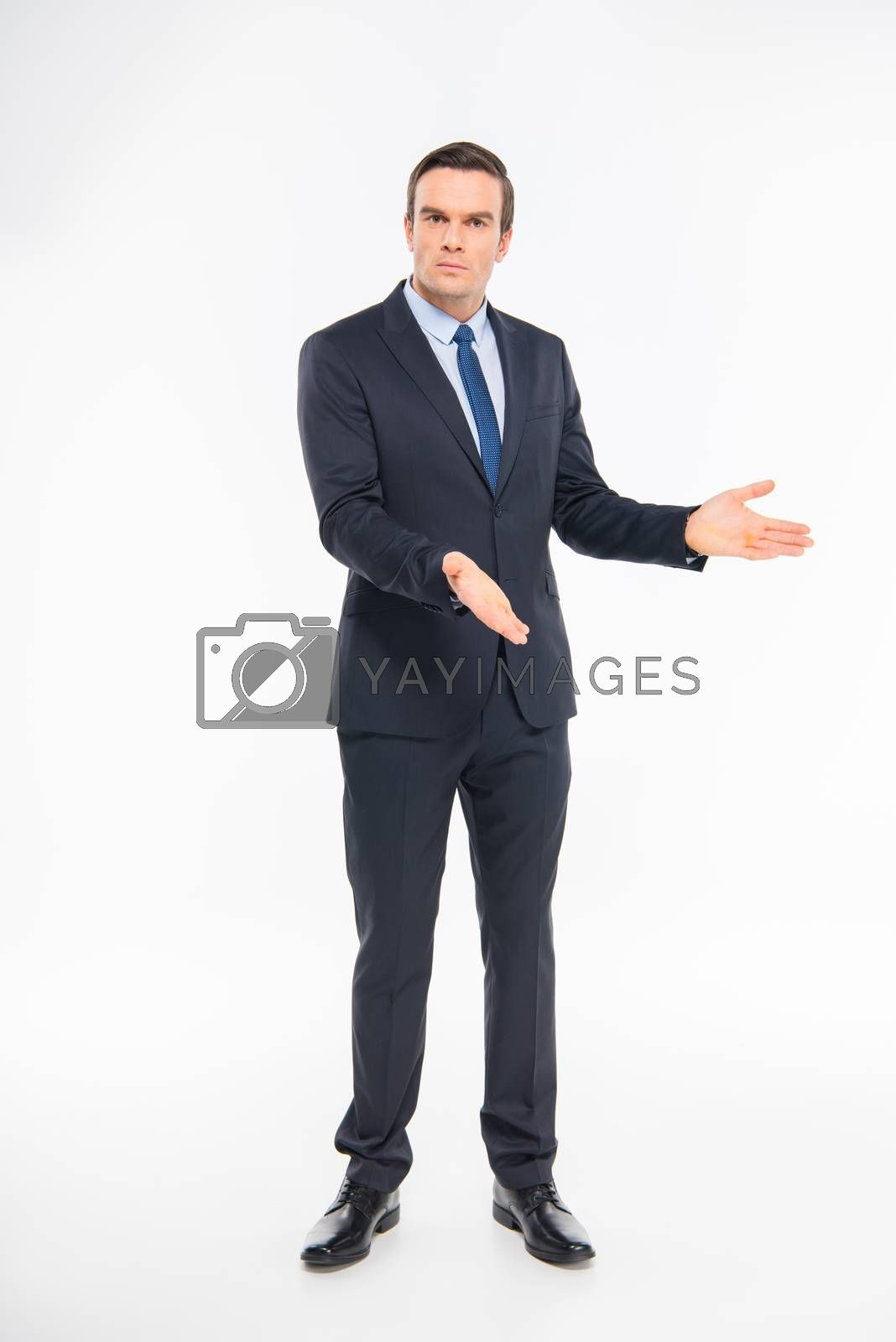 Professional businessman in suit gesturing with hands and looking at camera