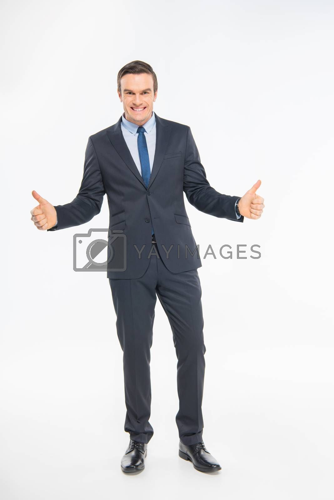 Professional smiling businessman showing thumbs up on white