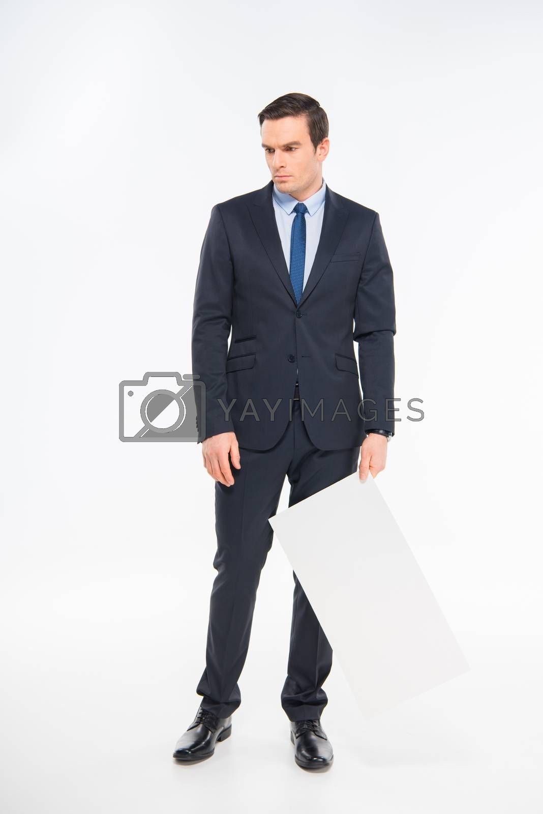 Tired businessman holding blank white card