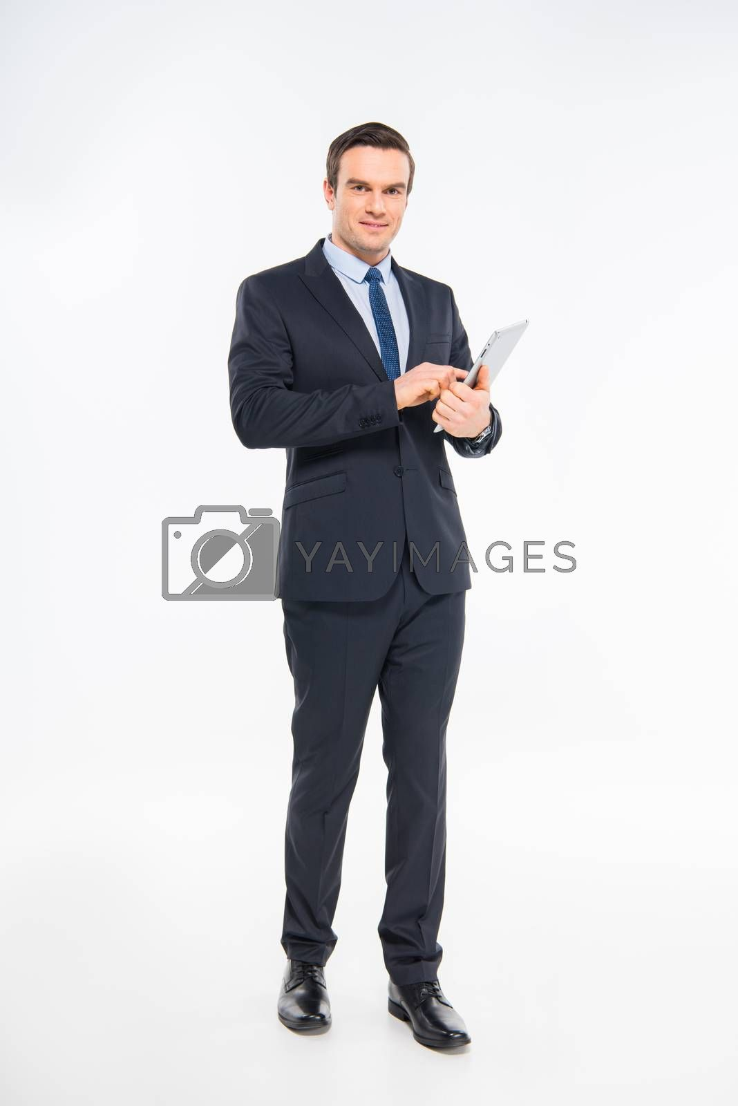 Professional young businessman using digital tablet on white
