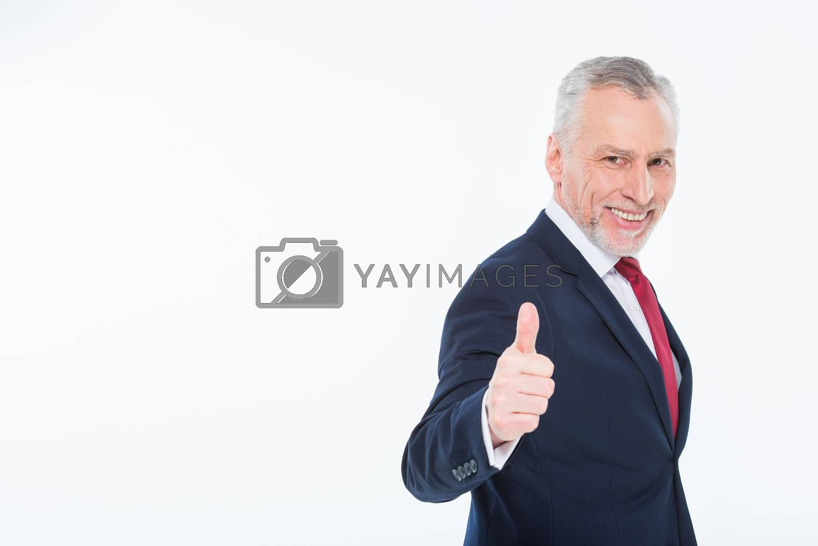 Handsome mature businessman showing thumb up on white
