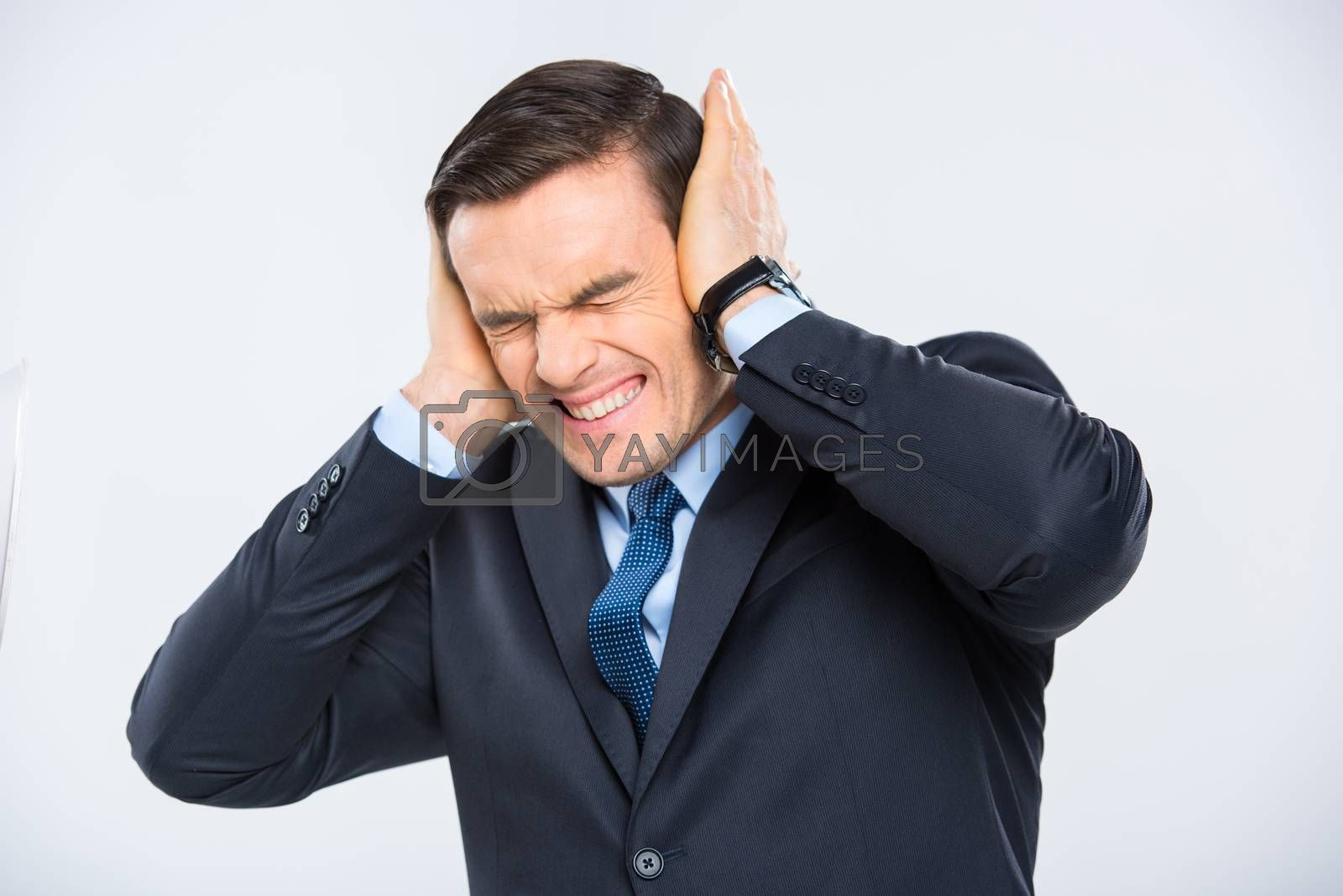 Stressed businessman closing his ears on white