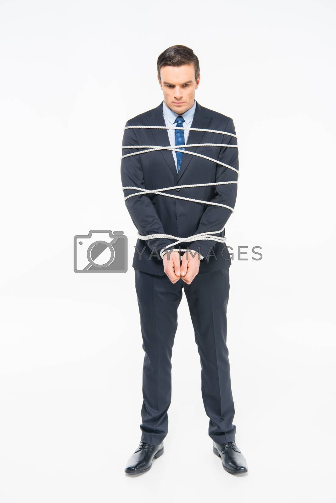 Sad young roped businessman on white