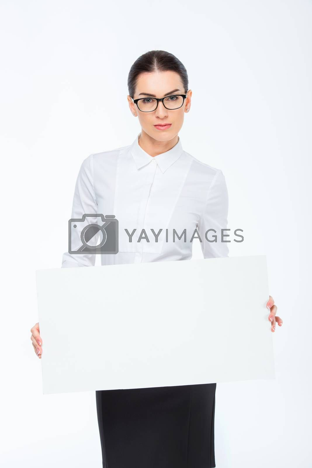 Young businesswoman holding blank card on white