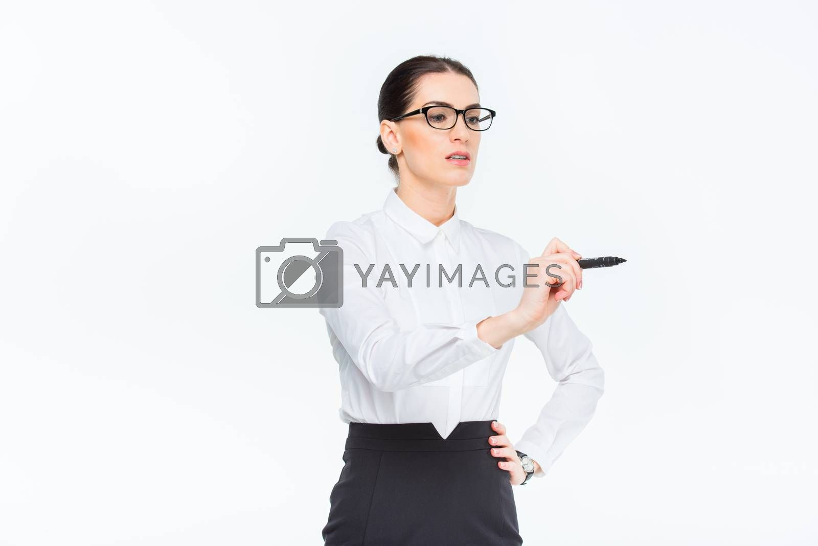 Businesswoman writing with marker by LightFieldStudios
