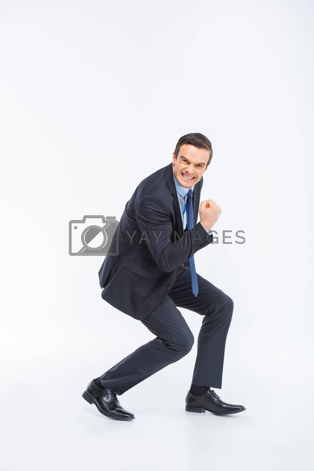 Young excited businessman celebrating on white