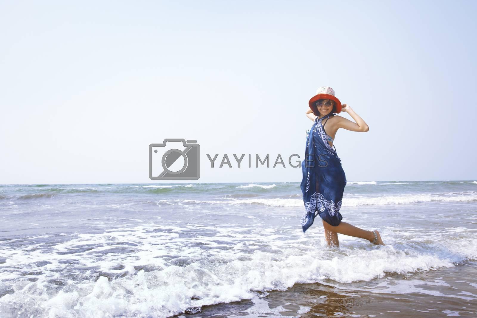 Happy woman at Atlantic ocean