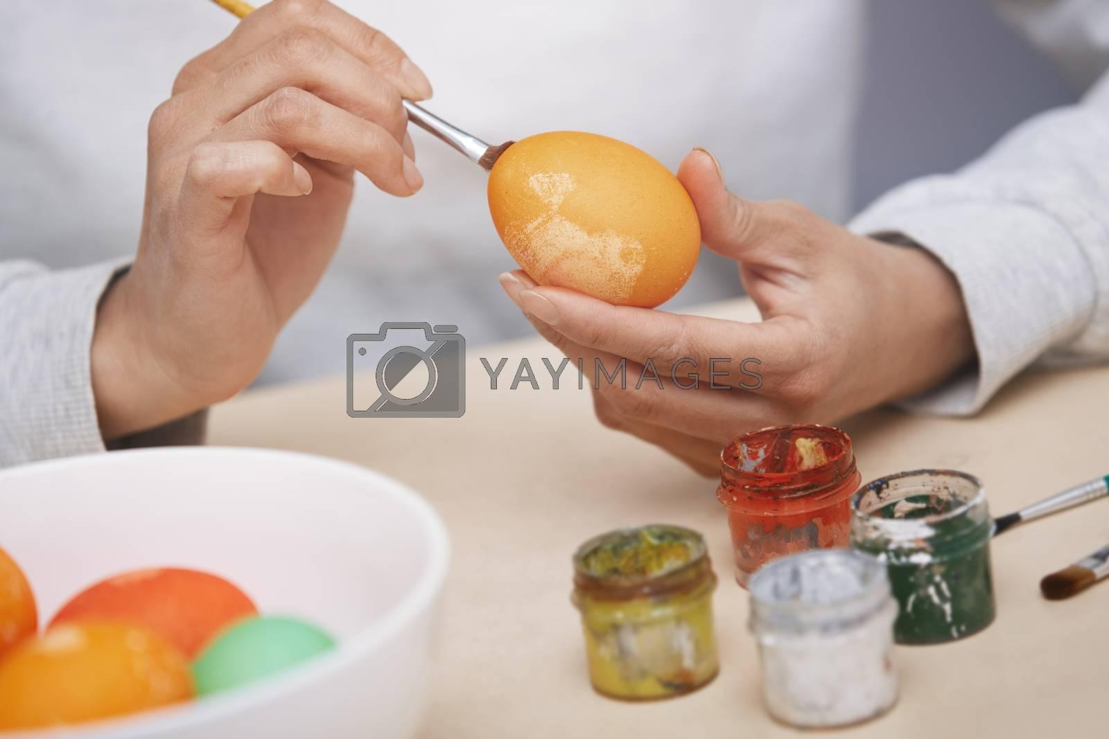 Woman preparing Easter eggs