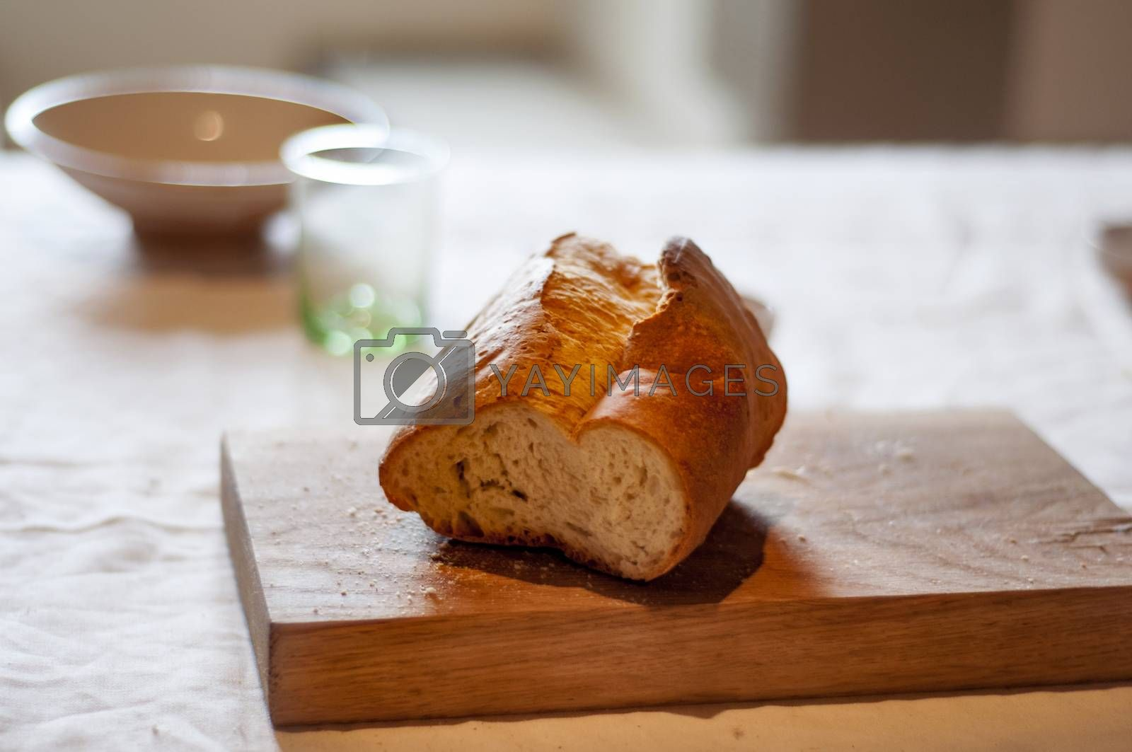 a piece of bread on a wooden cutting board