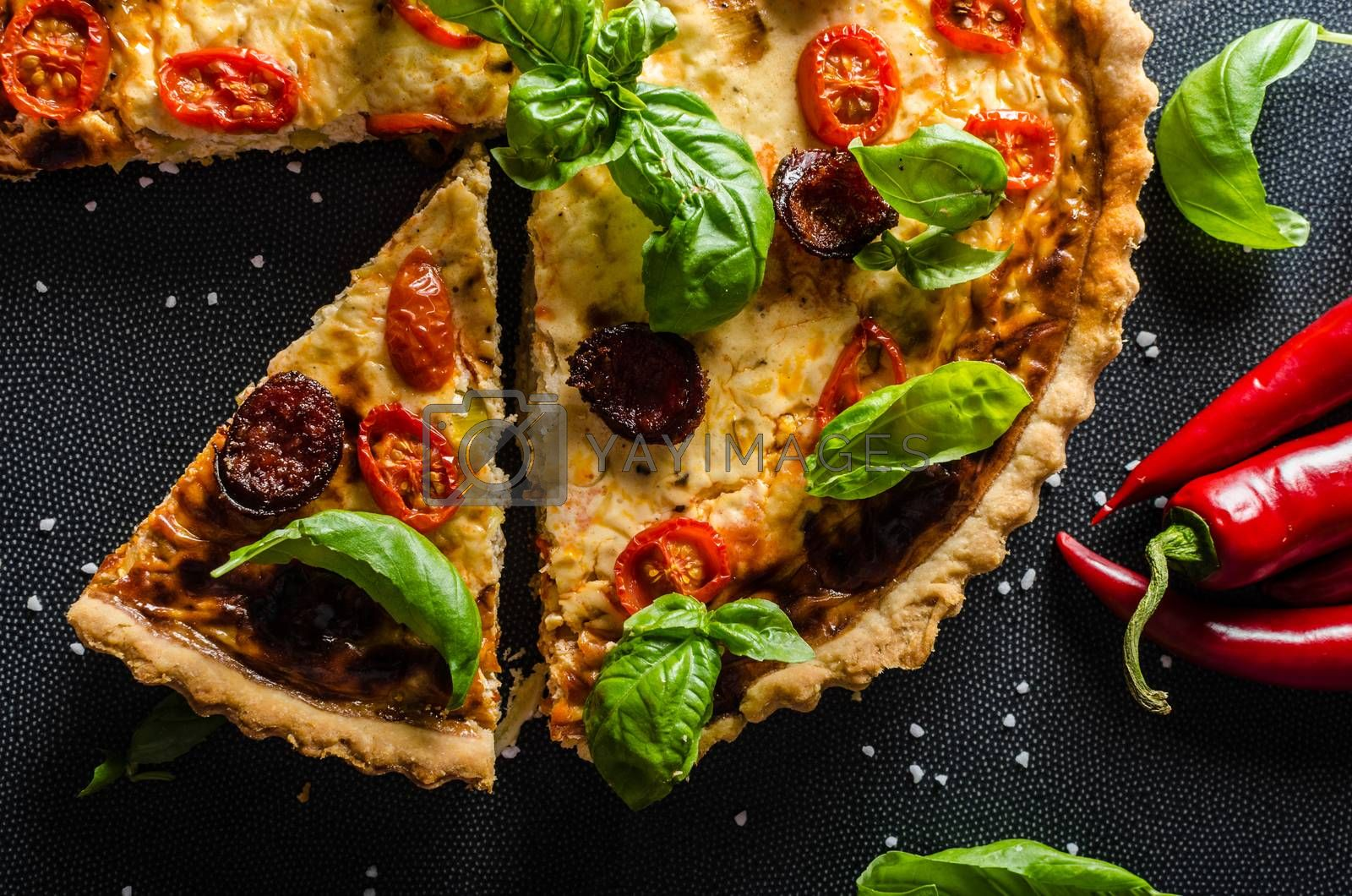 Homemade quiche with chili peppers, cheese and chorizo