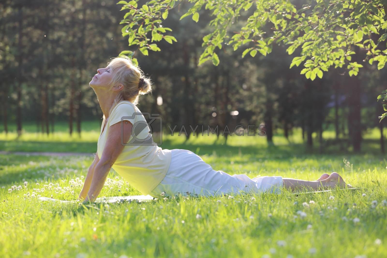 Yoga woman in park by destillat