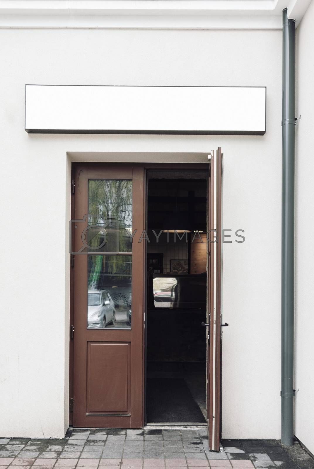 Cafe doors opened and modern empty outdoor signage mockup to add company logo