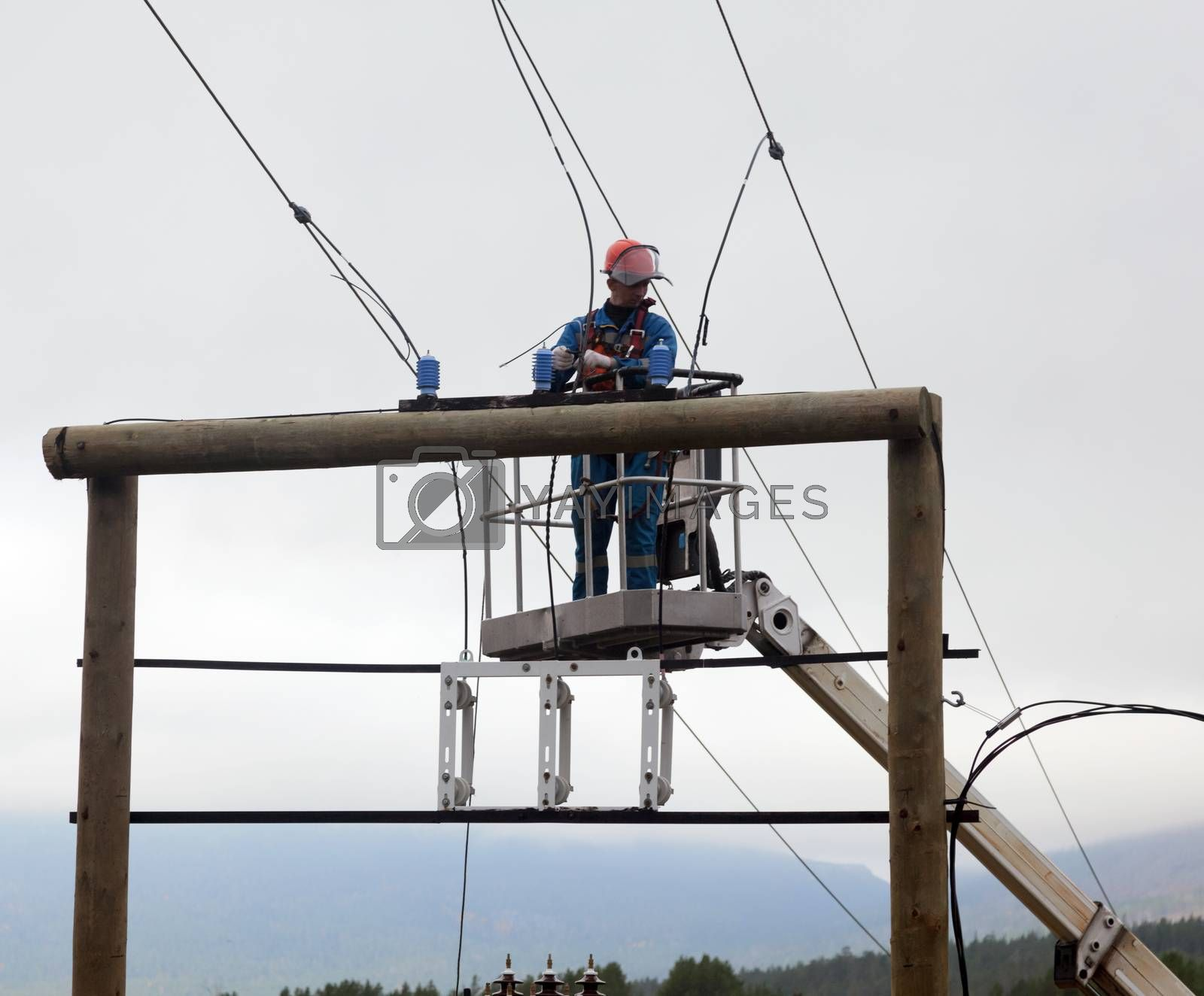 Electric is working on of transmission lines in a special lift vehicles