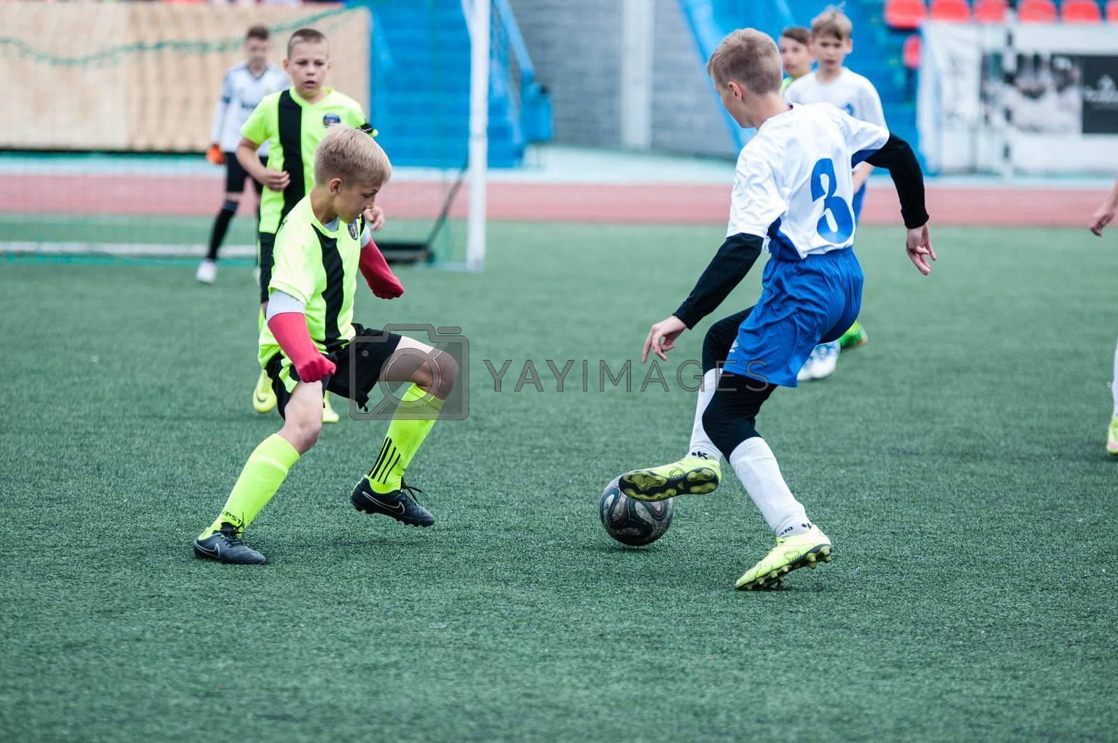 "Orenburg, Russia - 1 June 2016: The boys play football in the preliminary games football festival ""Lokobol-2016""."