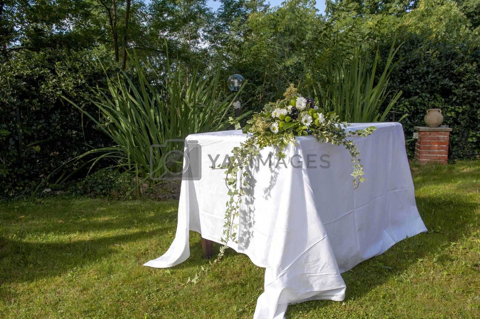 altar decorated with flowers for an outdoor wedding celebrated
