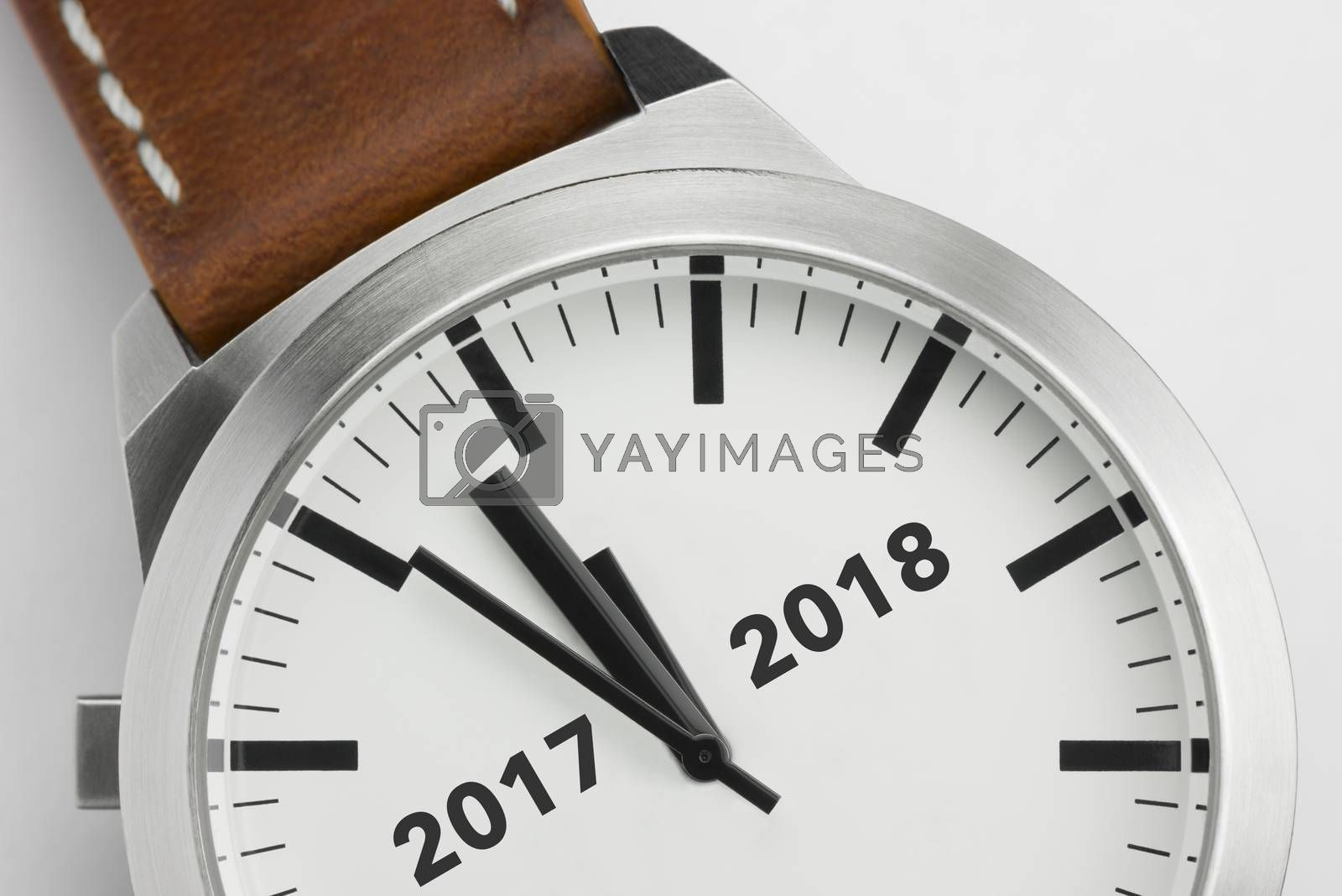 Analog watch with conceptual visualization of the turn of the year 2017 2018