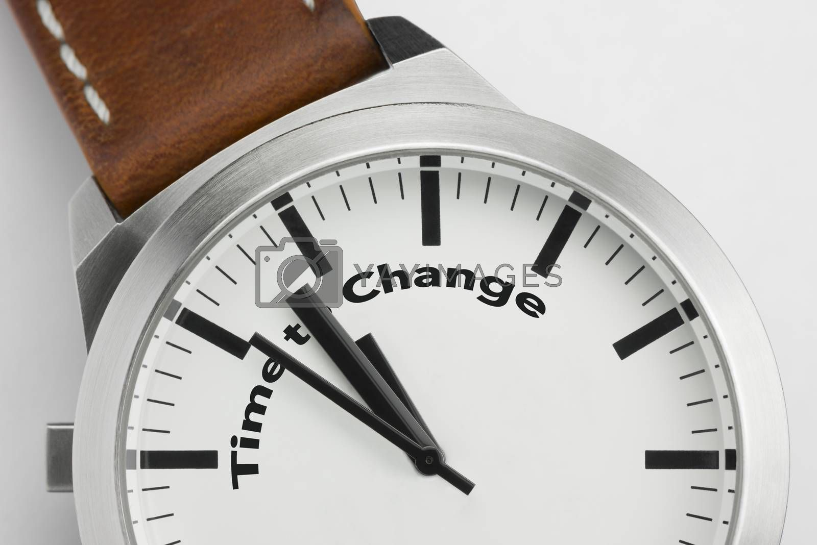 Analog watch with conceptual visualization of the text Time to Change