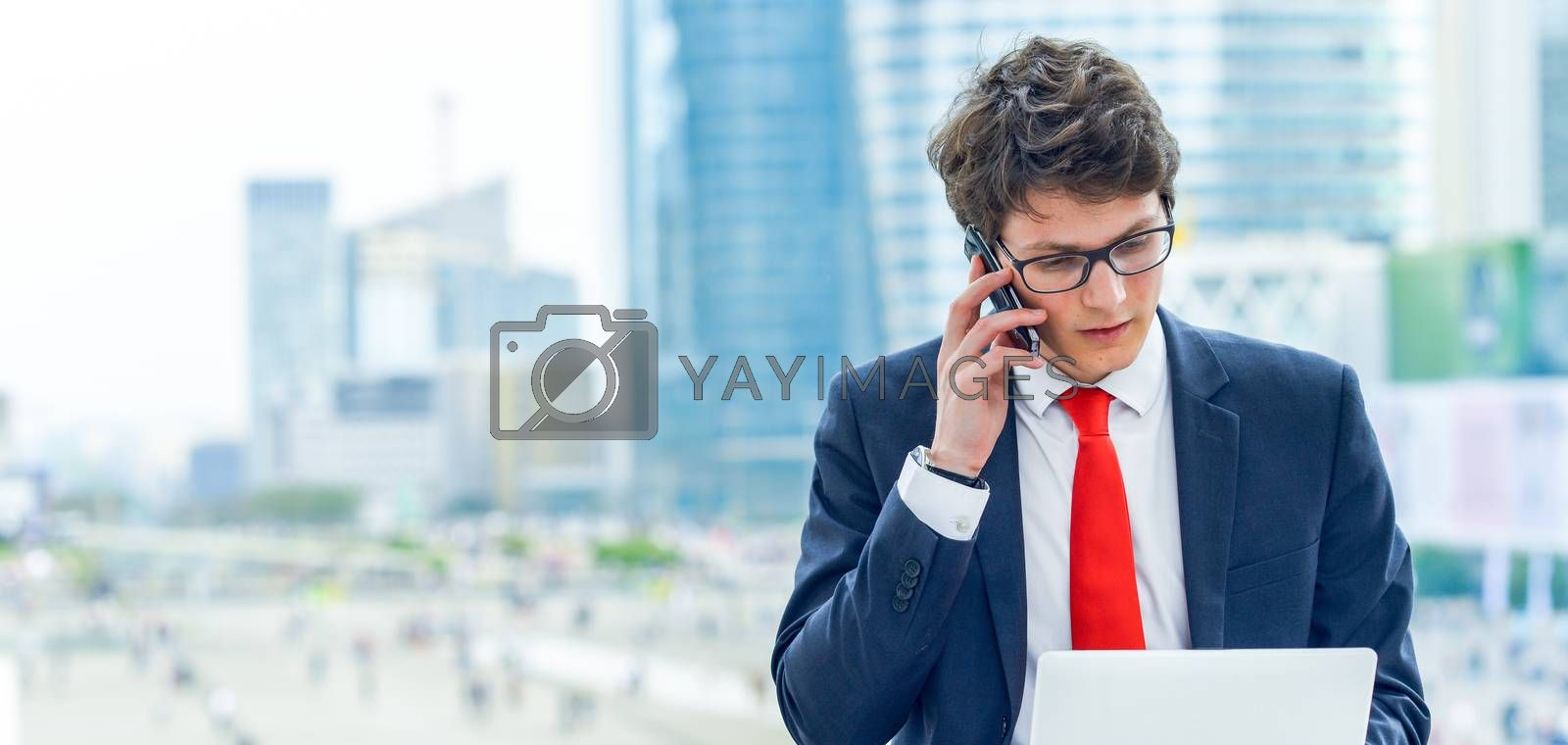 panoramic view on dynamic young executive calling outside, free of any constraint. Symbolizing a job search or a trade of outsourcing
