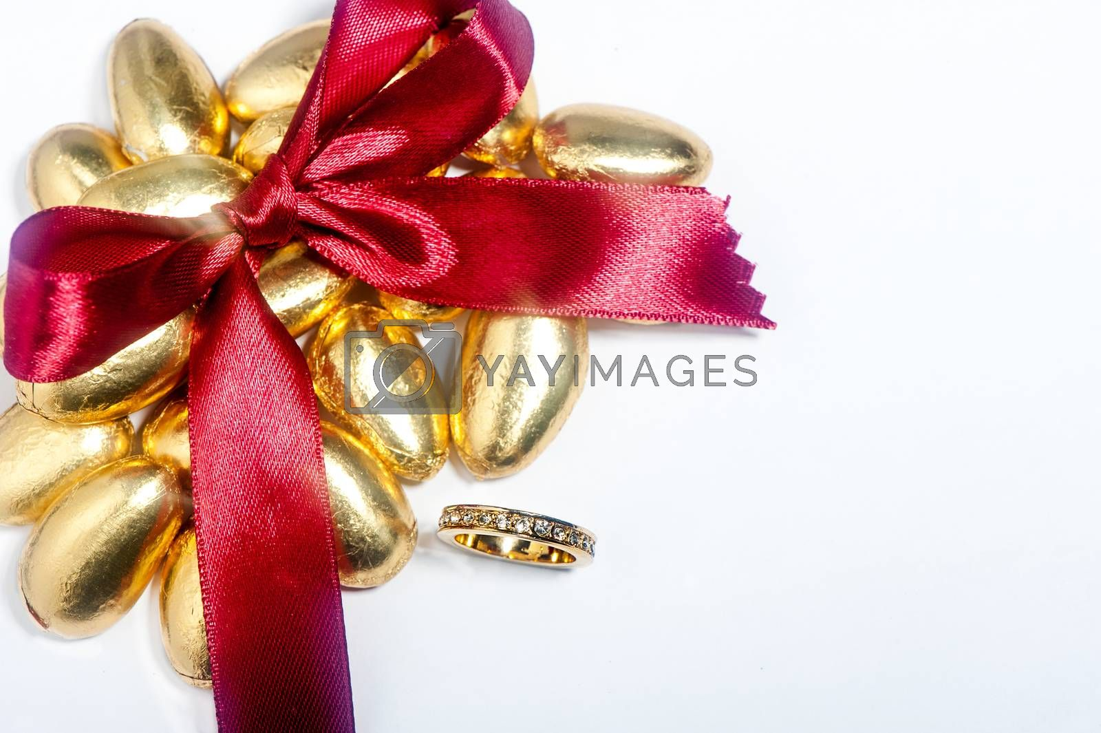 a isolated  wedding rings and satin bow